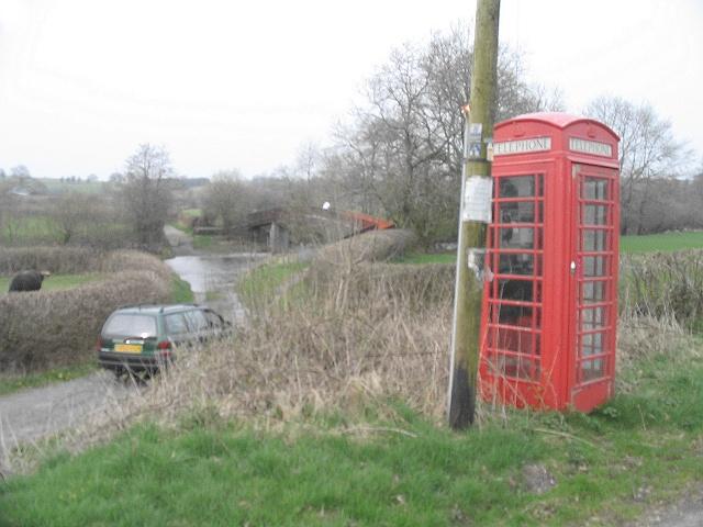 Phone box near crossing on River Irfon