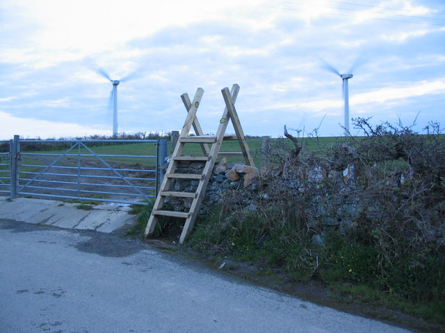 Stile and wind turbines near Cemaes