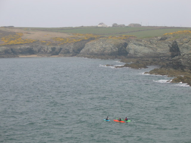 Canoeist leaving Porth Dafarch