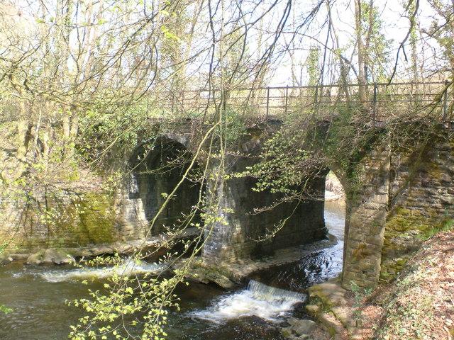Disused railway bridge across river Ely