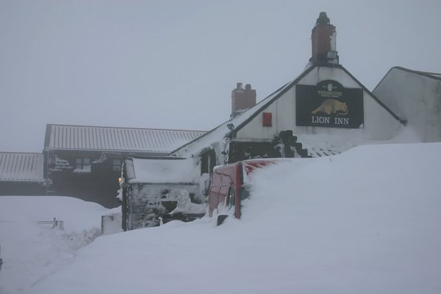 The Lion Inn with snowdrifts