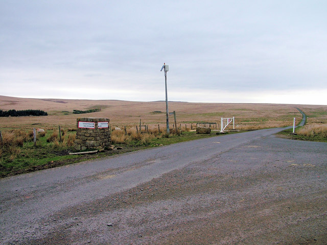 Another road junction, another flag pole, another gate, another fingerpost