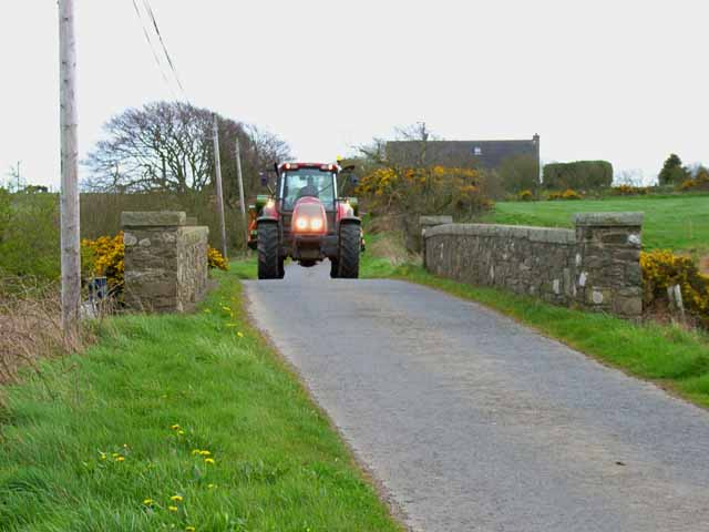 Tractor crossing the bridge over the Piltanton Burn