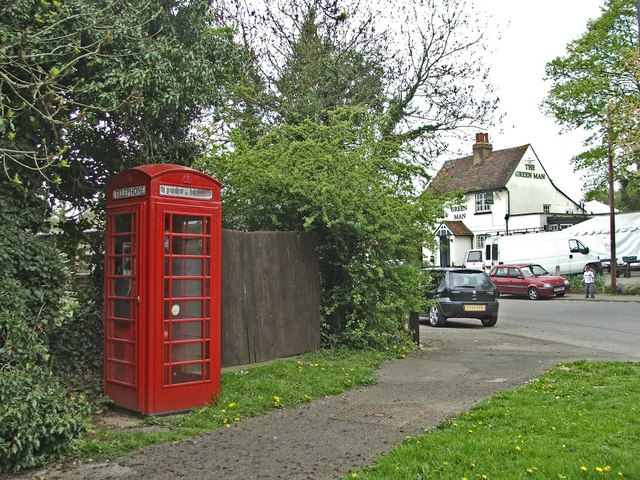 Red Telephone Box at Mill Green, Hertfordshire,  with the Green Man public house in the background