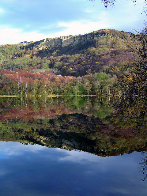 Whitestone Cliff reflects in Lake Gormire