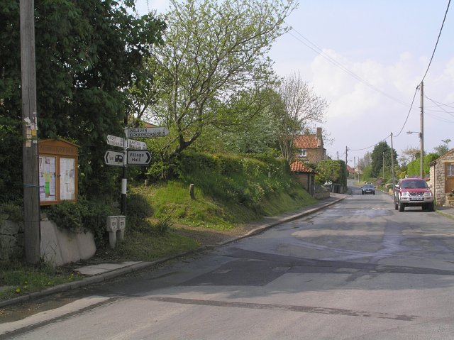 Noticeboard and junction at Wombleton