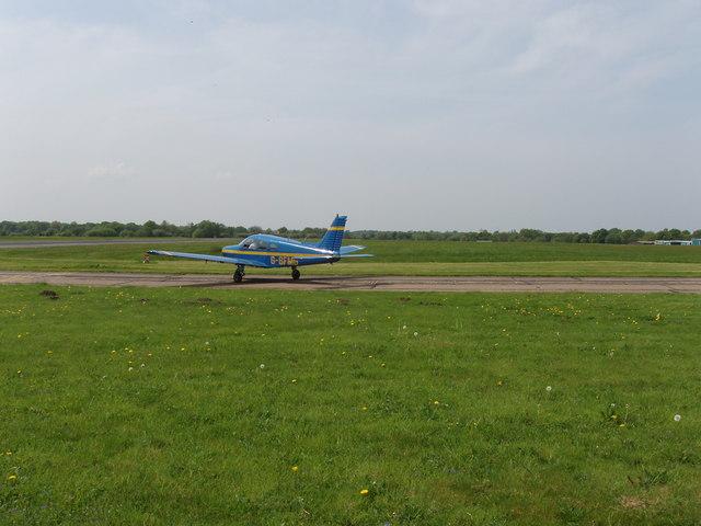 Light plane awaiting take-off, Fairoaks airport