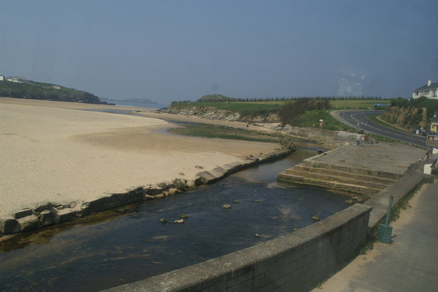 The river flowing across Porth Beach