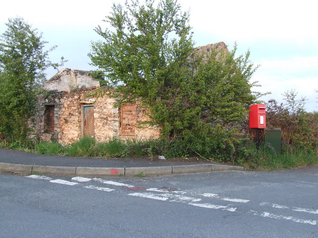 Derelict cottage and a post box