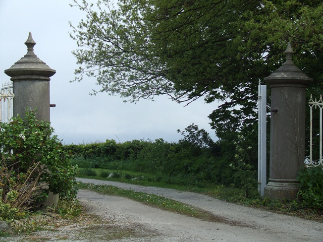Gate entrance alongside Cornelyn Lodge