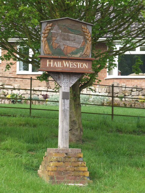 Village nameboard at Hail Weston.