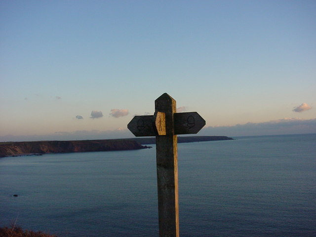 Marloes footpath sign and view of sea
