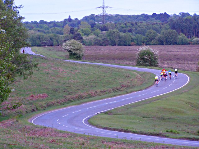 Cyclists heading for the Waterside at dusk, New Forest
