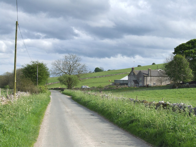 The road to Parwich passing White Cliffe Farm.