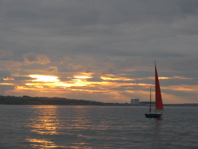 Red Sails in the Sunset off Cummingston.