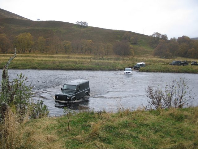 Grouse Beaters cross a ford on the River  Findhorn.