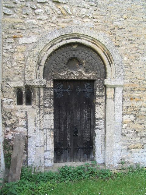 Door with tympanum. Church of St Medard and St Gildard, Little Bytham