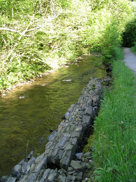 Fallen riverbank wall on river Clydach