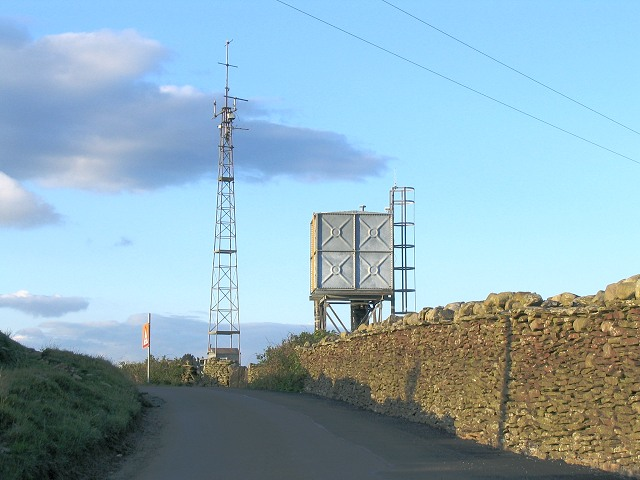 Mast and water tower in hills above Trebanos