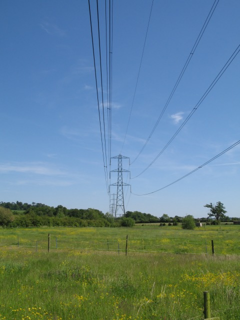 Pylons over open countryside