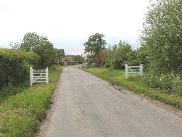 Gates as street furniture at entrance to Fencott