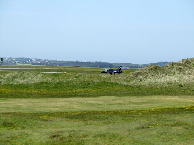 Fairway on golf course, with hawk jet
