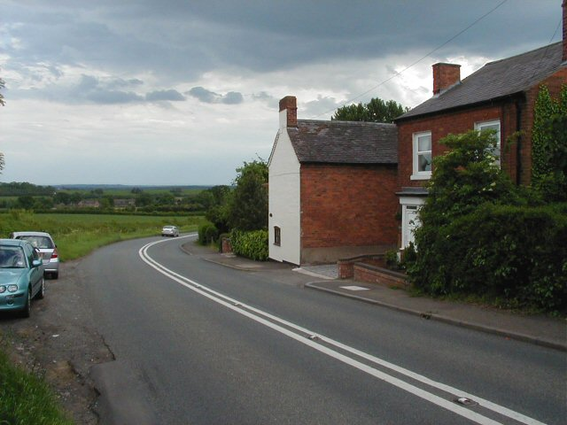Road, fields and cottages