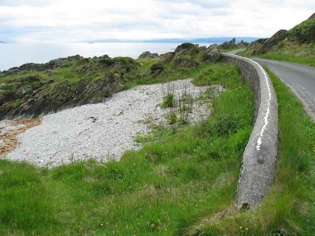 Shoreline wall and beach on the B8001 near Skipness.