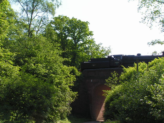 Steam train passing over a bridge