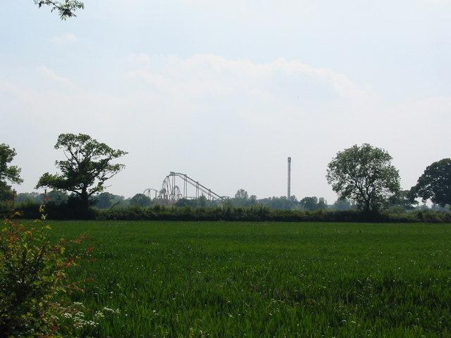 View of Flamingo Land amusement park across agricultural land