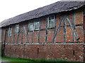 SJ6741 : Old Farm building alongside the road by Nigel Williams