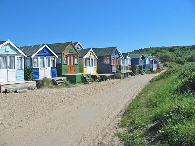 Beach huts on sand spit below Hengistbury Head Dorset