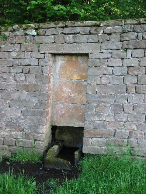 A sealed doorway in the wall surrounding Swinton Park