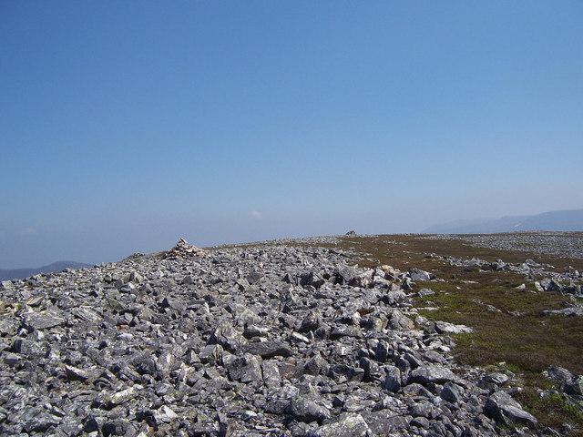 Cairns on the stony summit of Creag nan Gabhar.