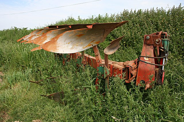 Plough on the edge of the field.