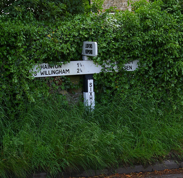 The Overgrown Signpost