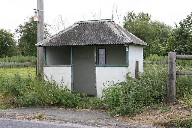Forlorn bus shelter on A338 near railway bridge.