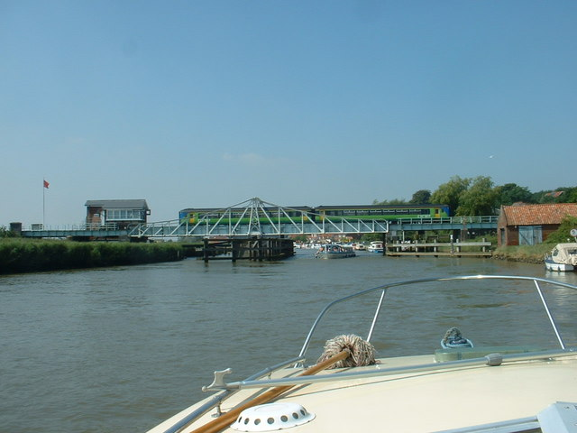 Train and boat at Reedham Swing Bridge