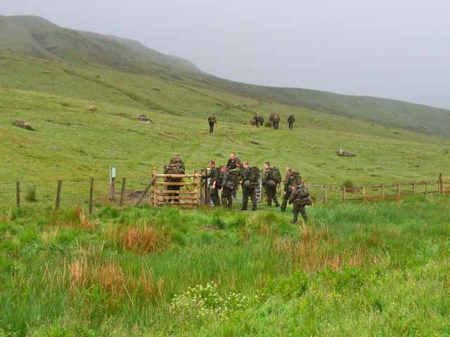 Troops yomping up the slopes of Bryn Du.