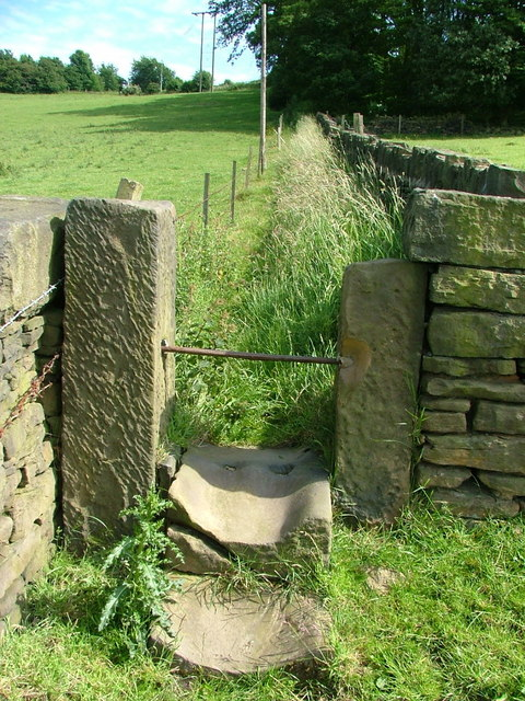 A well worn stile on the path up to Back Lane