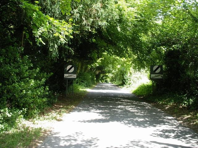 """Leaving village"" sign, West Winterslow"