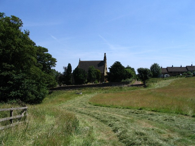 Hay field and Hollowell Church