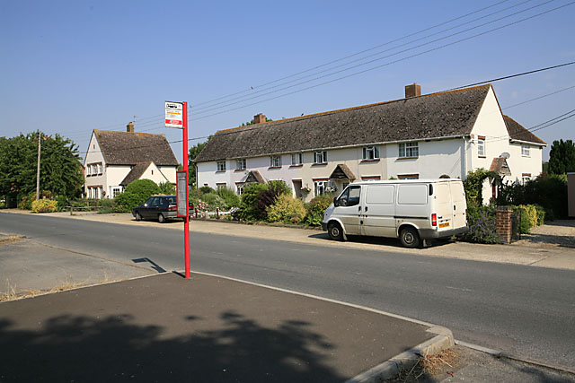 Bus stop & housing on principal road in Nunton