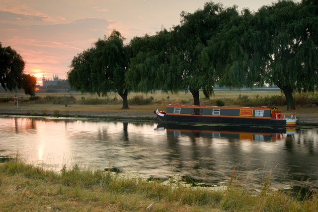 Narrow boat on the river Nene at dusk, Peterborough