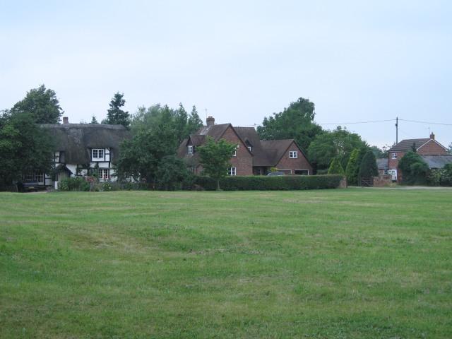 Houses beside the green in Poulshot