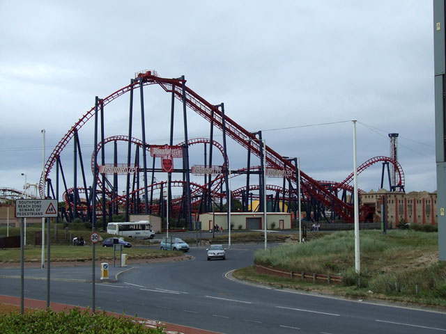 Rollercoaster beside a roundabout