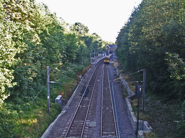 Train leaving Winchmore Hill Station towards Enfield Chase