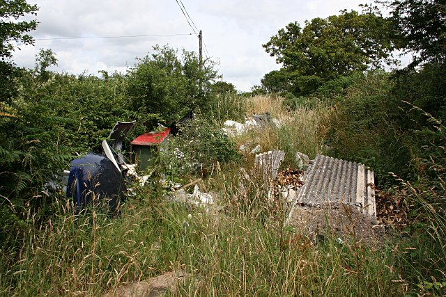 Fly Tipping Behind the Hedge