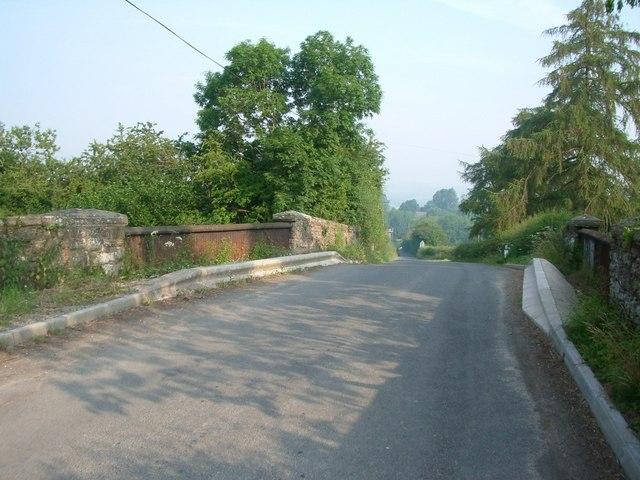 Road bridge over disused railway line