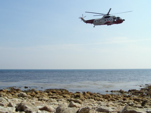 Coastguard helicopter off Bran Point